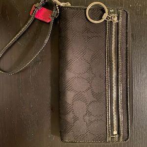 Coach zip up wallet.